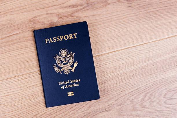 American passport on desktop stock photo
