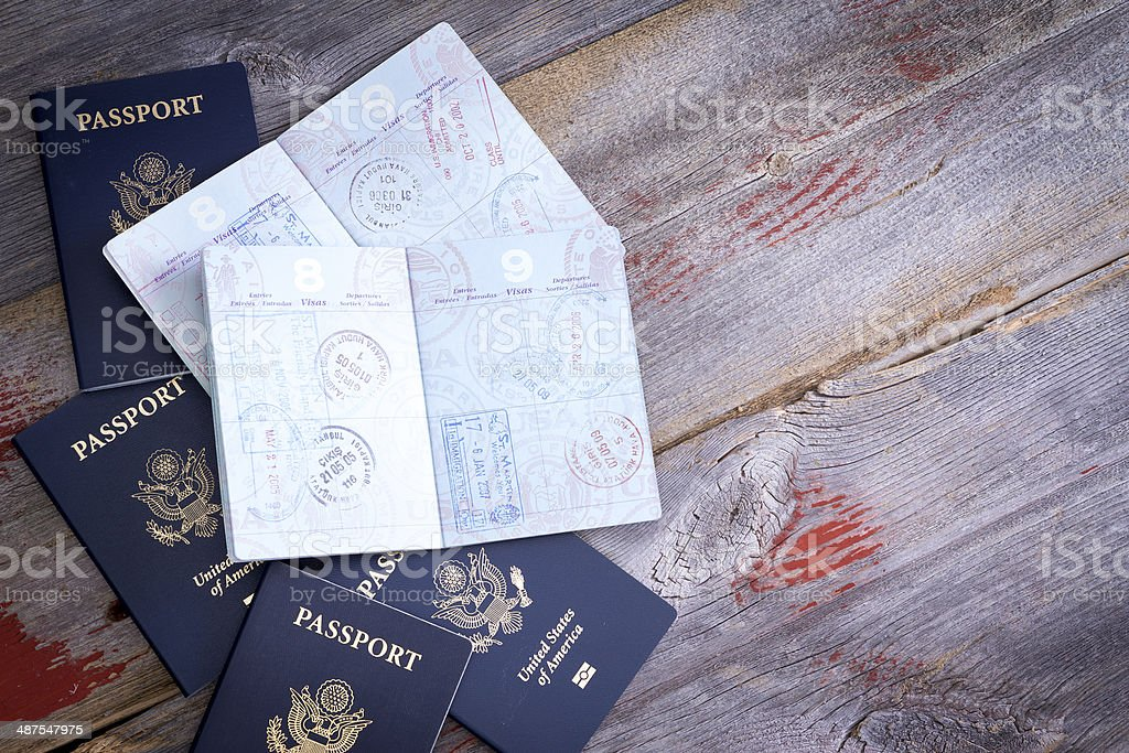 American passports open to reveal stamps stock photo