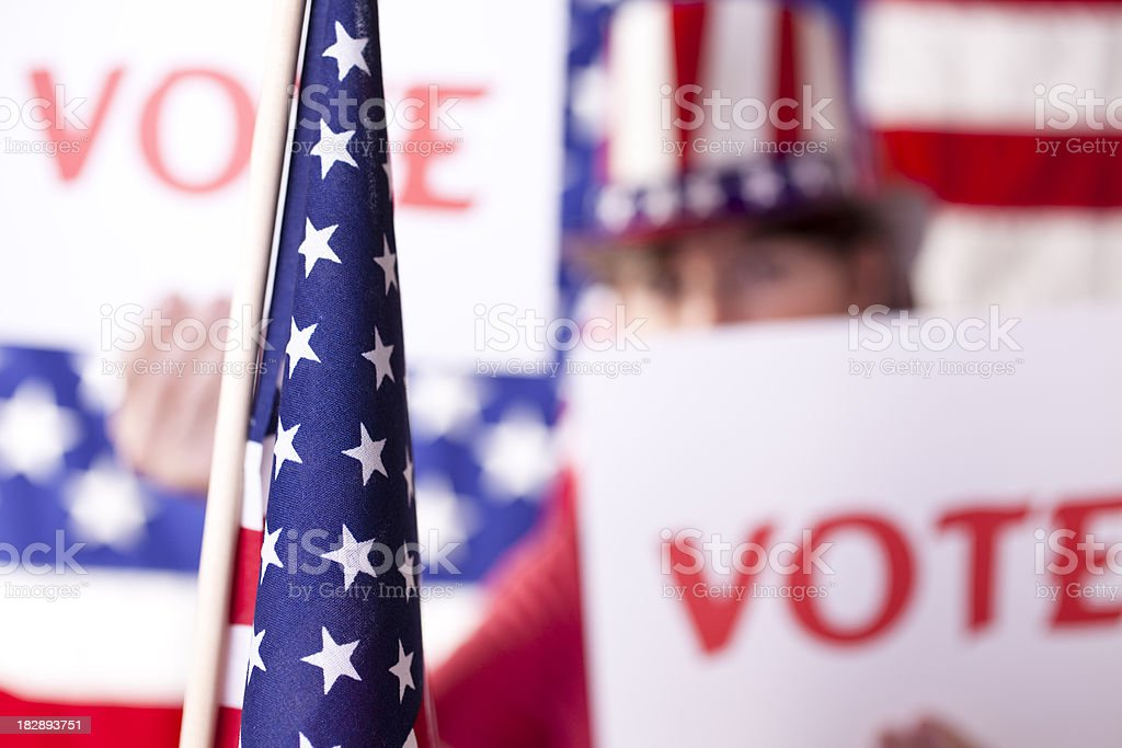 American political rally with VOTE signs. USA flag. Voting. Election. royalty-free stock photo