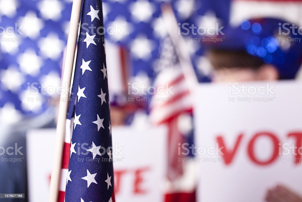 American political rally with VOTE signs. USA flags. royalty-free stock photo