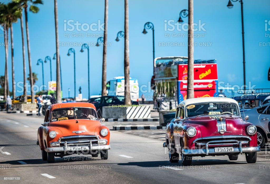 HDR - American Pontiac and Chevrolet classic cars drive on the famous Malecon in Havana Cuba - Serie Cuba Reportage stock photo