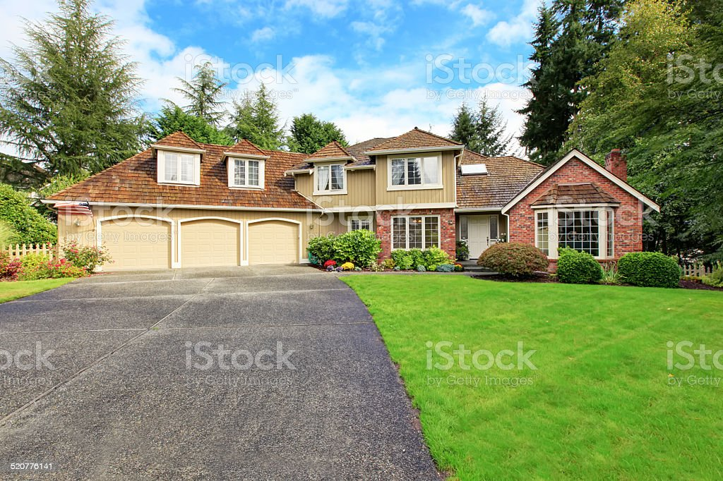 American real estate. Luxury house exterior with brick trim stock photo