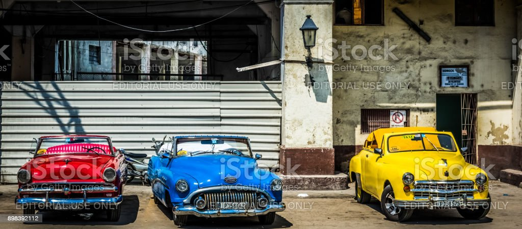 HDR - American red, blue, yellow Desoto, Buick an Chevrolet convertible classic cars parked lined up in Havana City Cuba - Serie Cuba Reportage stock photo