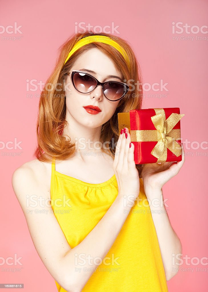 American redhead girl in sunglasses with gift. royalty-free stock photo