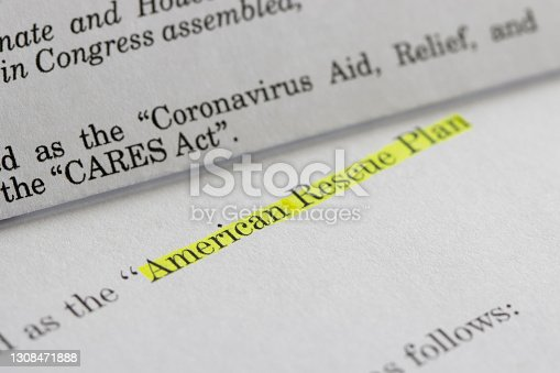 istock American Rescue Plan Act of 2021 and CARES Act 1308471888
