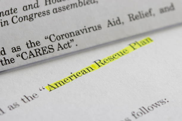 American Rescue Plan Act of 2021 and CARES Act Closeup of the documents of both the Cares Act (Coronavirus Aid, Relief, and Economic Security Act) and the American Rescue Plan Act (ARPA) of 2021. A comparison between two acts. american culture stock pictures, royalty-free photos & images