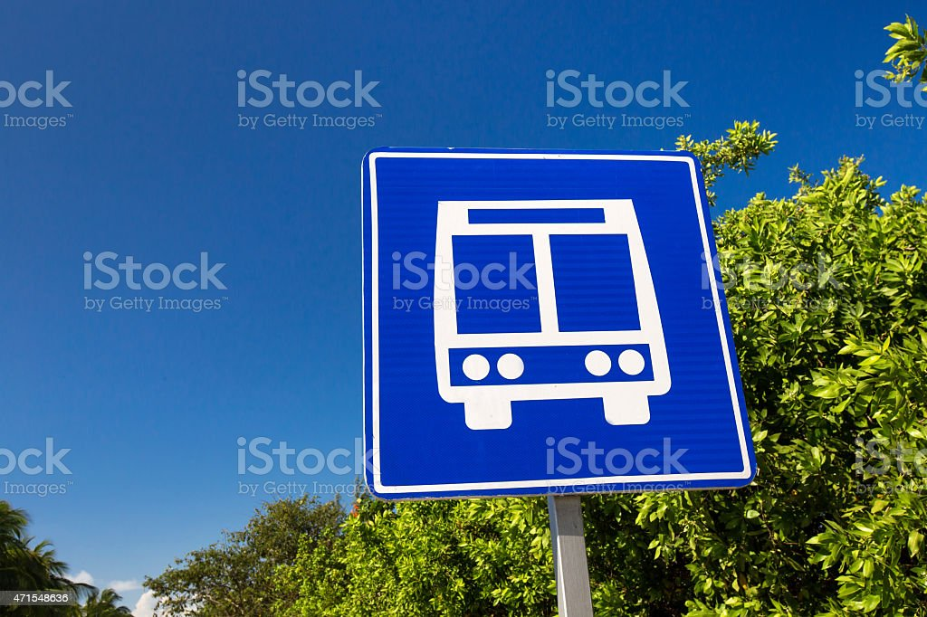 American road public bus stop sign on caribbean street stock photo