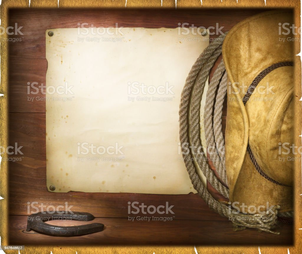 American rodeo cowboy background with western hat and lasso stock photo