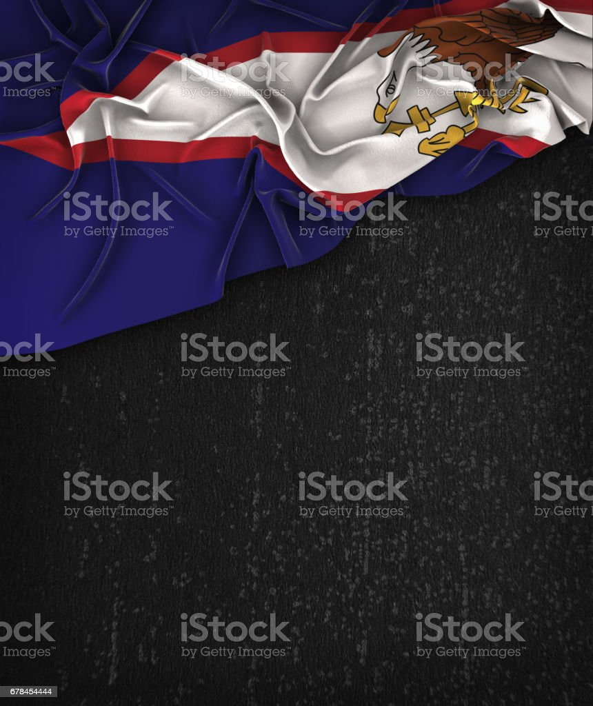 American Samoa Flag Vintage on a Grunge Black Chalkboard With Space For Text royalty-free stock photo
