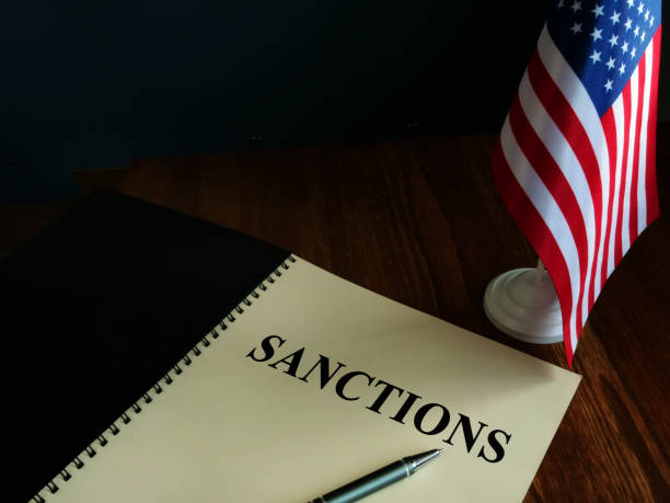 American sanctions and USA flag on table. American sanctions and USA flag on table. sanctions stock pictures, royalty-free photos & images