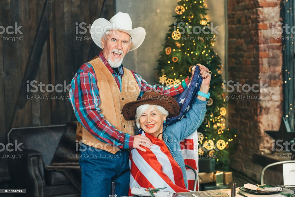 American senior couple enjoying new year party at home stock photo
