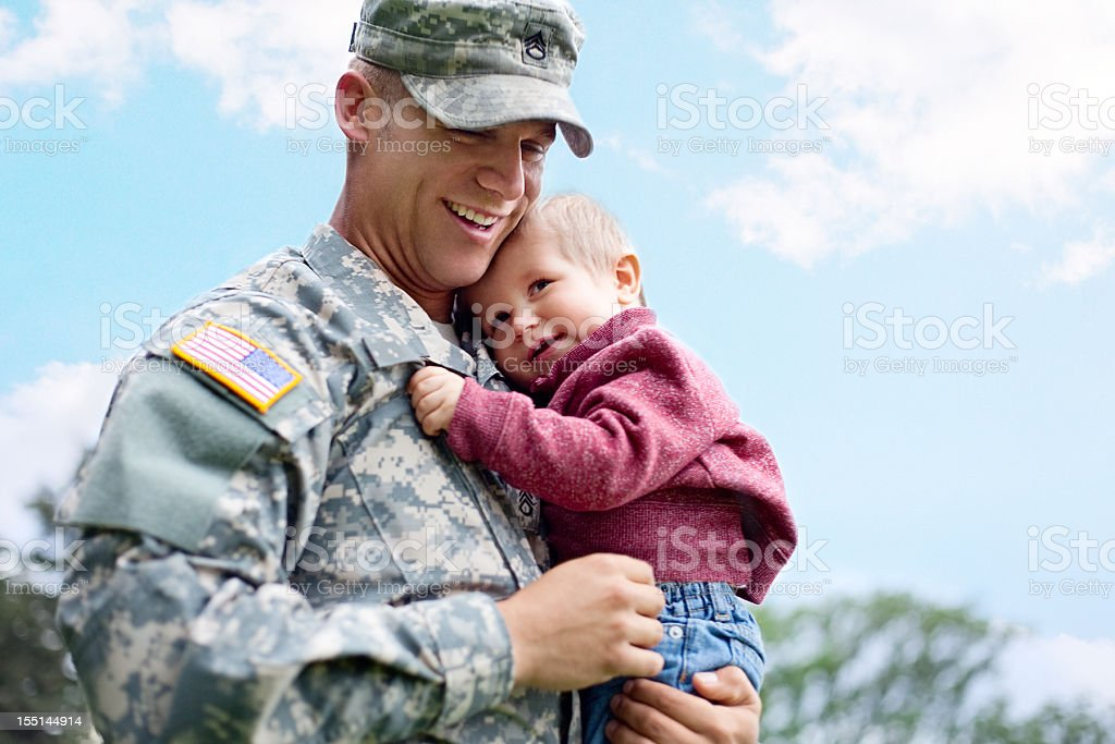 American soldier and son in a park stock photo