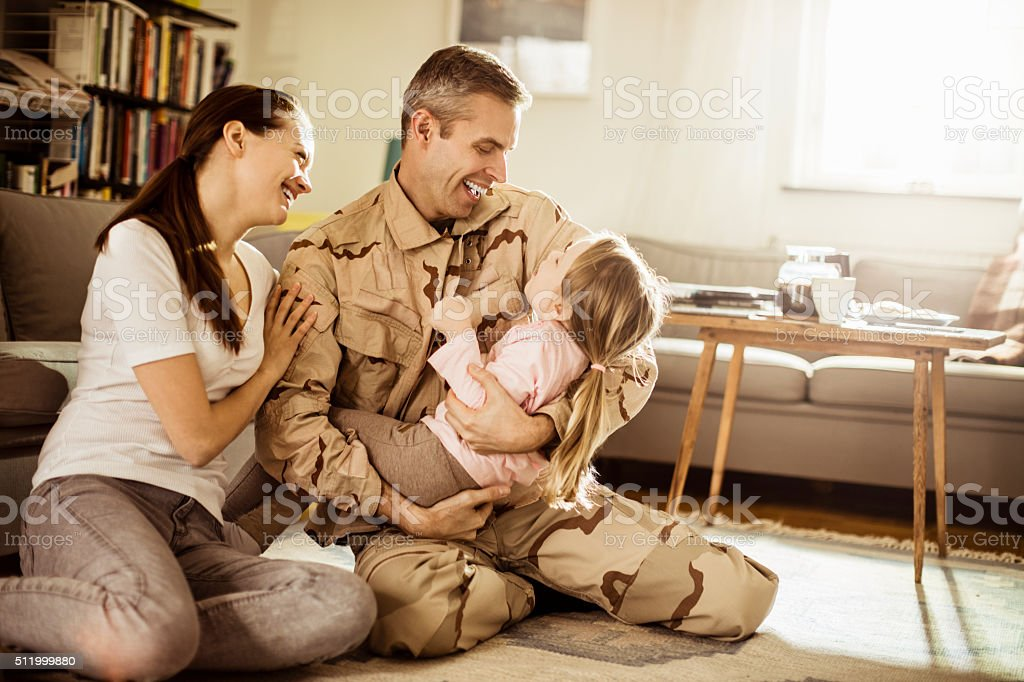 american soldier finally at home with his family stock photo more pictures of 2 3 years istock. Black Bedroom Furniture Sets. Home Design Ideas