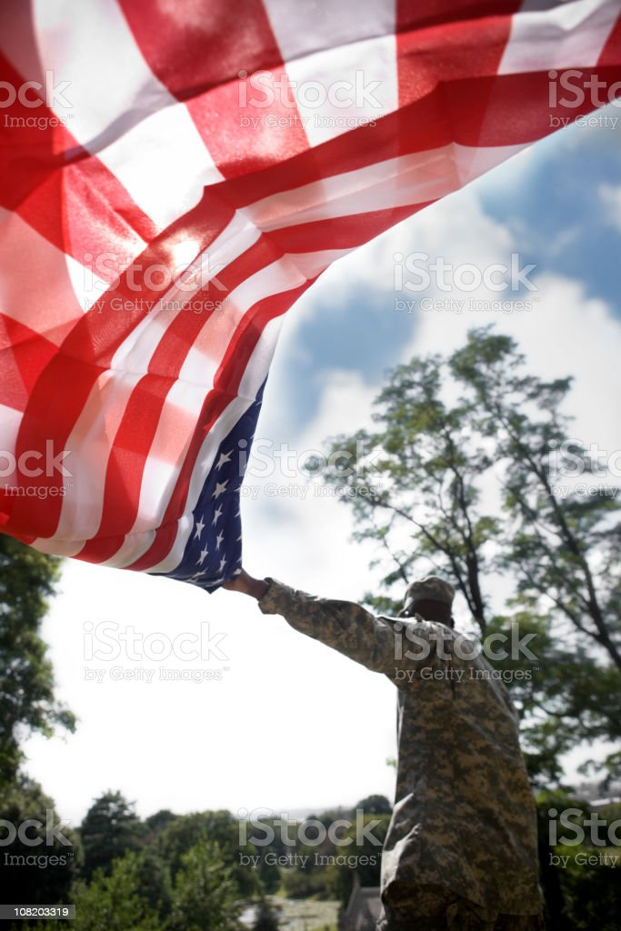 Army Soldier Waving American Flag Behind Him, Copy Space royalty-free stock photo