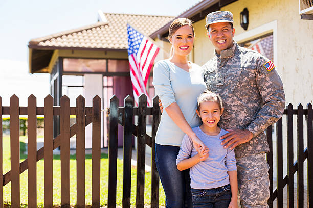 american soldier reunited with family - armed forces stock photos and pictures