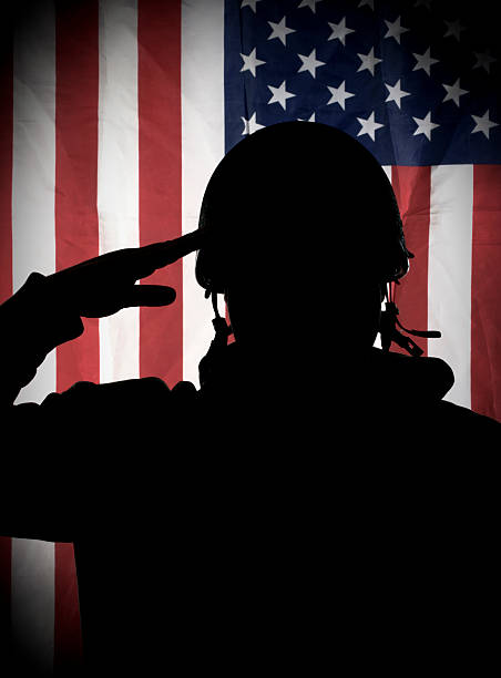 american usa soldier saluting to usa flag stock photo