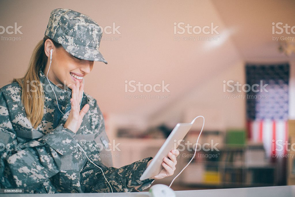American soldier talking with her family stock photo