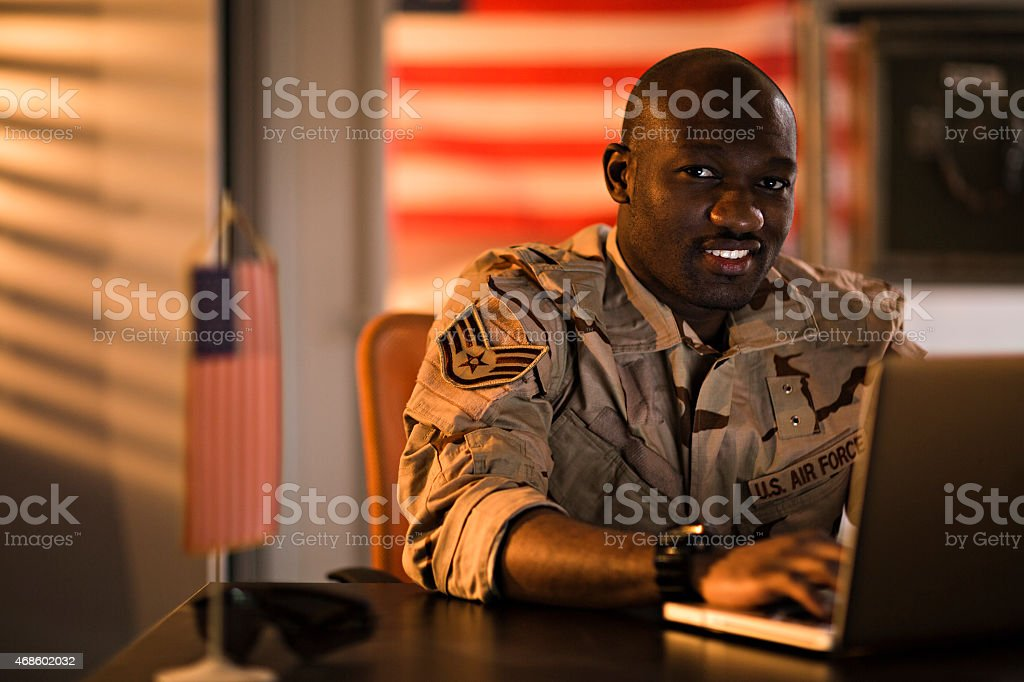 American soldier using laptop Close up of american soldier using laptop 2015 Stock Photo