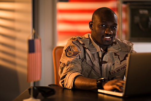 American Soldier Using Laptop Stock Photo - Download Image Now