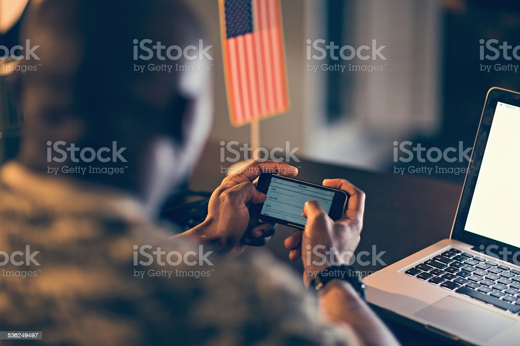 American soldier using mobile phone stock photo