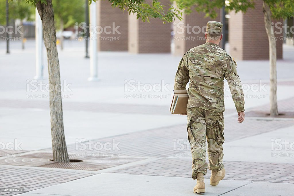 American Soldier with books stock photo