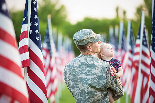 american soldier with daughter - memorial day stok fotoğraflar ve resimler