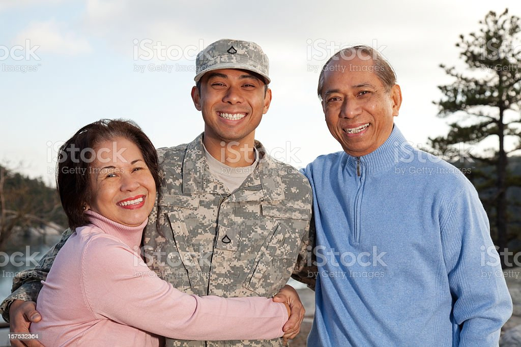 American Soldier with His Parents royalty-free stock photo