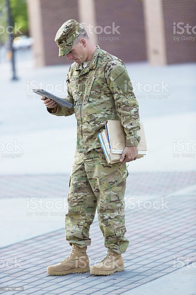 American Soldier with reading stock photo