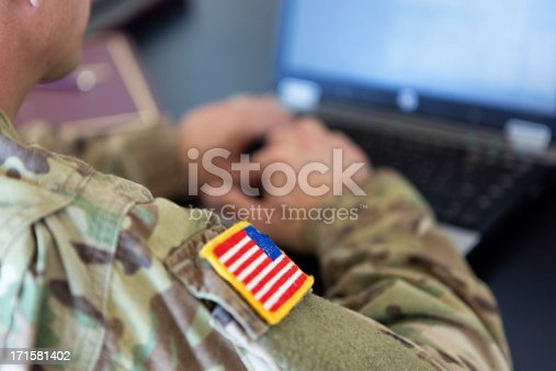istock American soldier working on laptop 171581402
