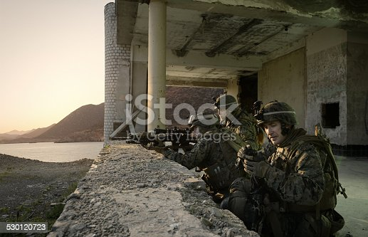 istock American soldiers guarding the building. 530120723