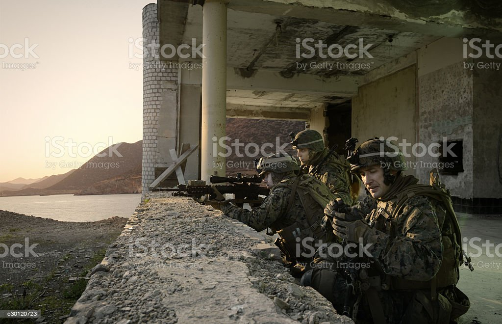 American soldiers guarding the building. stock photo