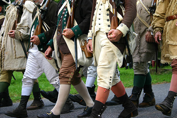 American Soldiers Men dressed up like colonial soldiers in the Battle at the Brandywine reenactment. colonial style stock pictures, royalty-free photos & images