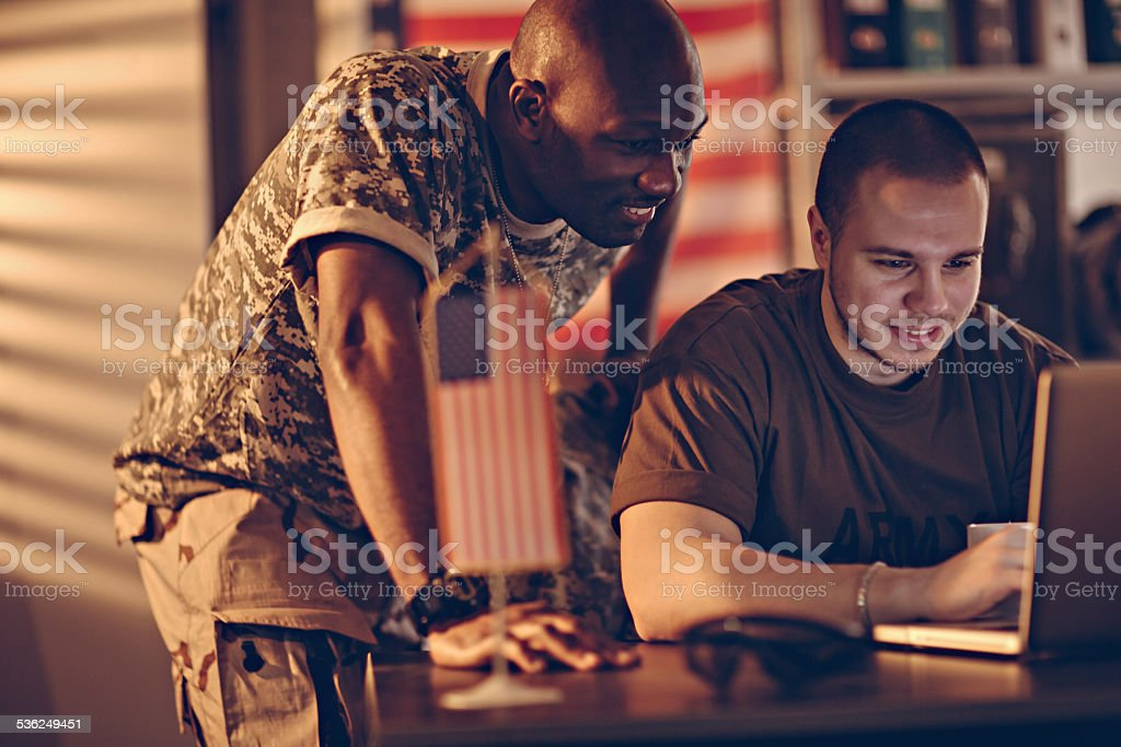 American soldiers using laptop stock photo
