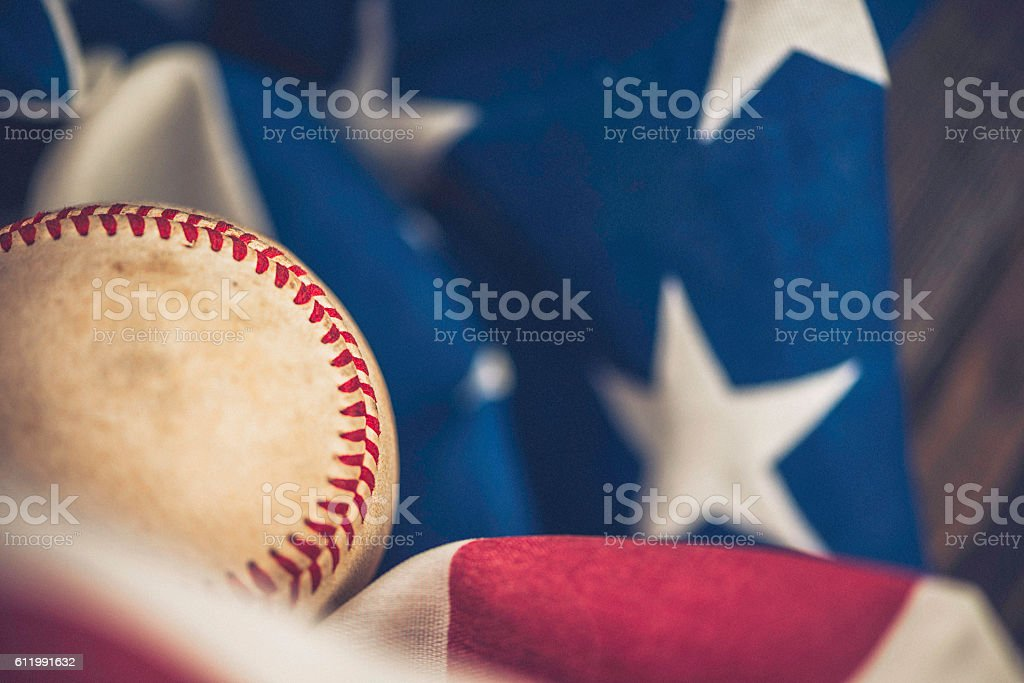American sports. Worn softball with American flag and wood background – Foto