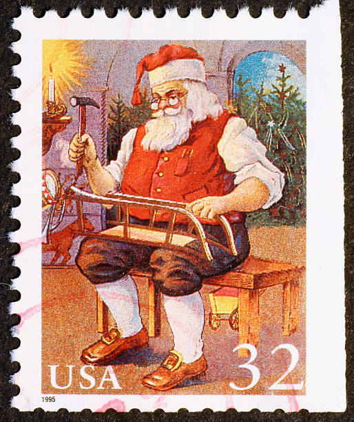 American Stamp With Santa Claus Building A Sleigh Stock Photo