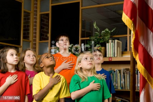 istock American Students Pledging Allegiance to the Flag 157381380