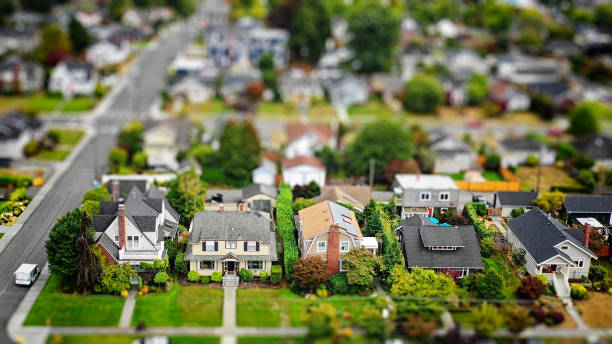 American Suburban Neighborhood Tilt-shift Aerial Photo Aerial photo of an American suburban neighborhood with a tilt-shift effect drone point of view stock pictures, royalty-free photos & images