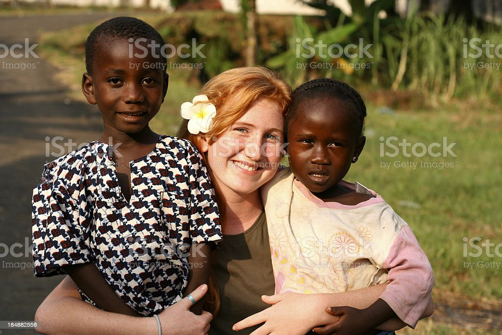 American Teen with African Children stock photo