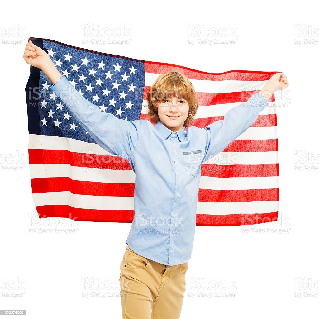 American teenage boy waving star-spangled banner stock photo