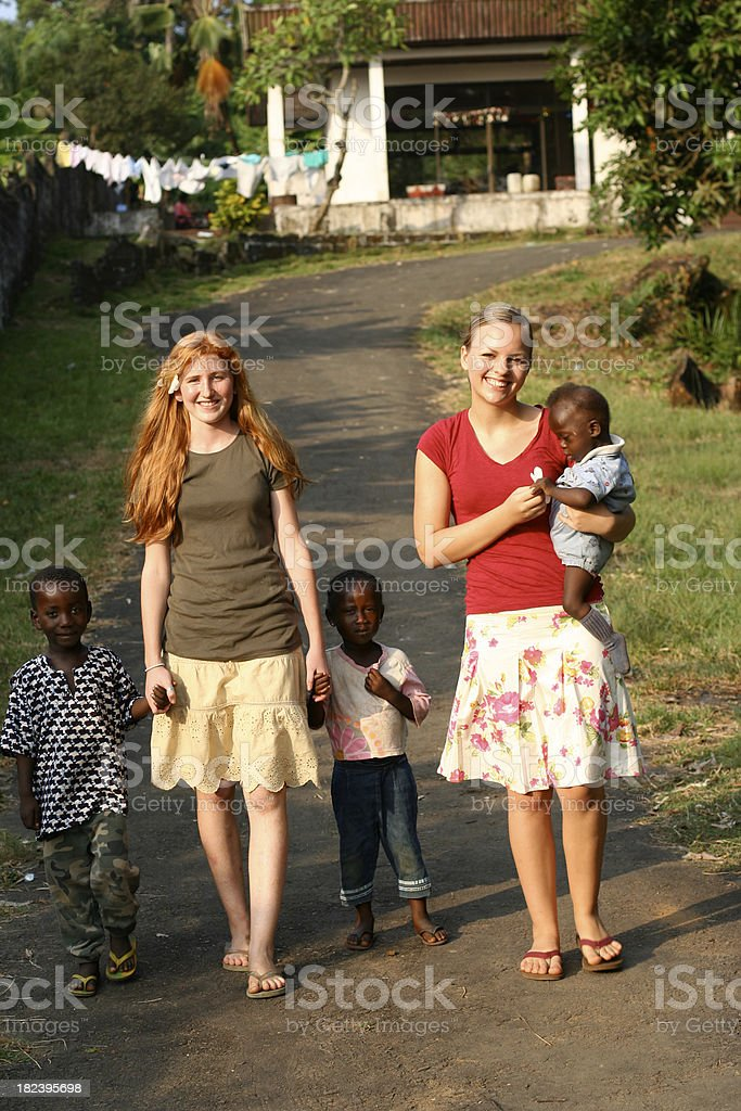 American Teens with African Children royalty-free stock photo