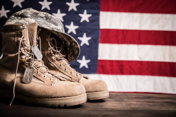 American veterans day theme with military boots hat usa flag picture id1041861964?b=1&k=6&m=1041861964&s=612x612&w=0&h=wysh3v hm4o3pnaldaef4ja ixx0wr9cizdrglaqzig=