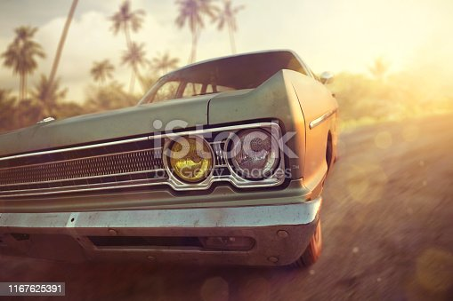 Old American station wagon driving on a road during sunset. Palm trees in the background, warm sun rays and no people.