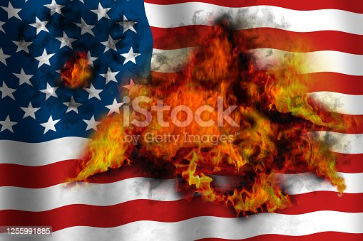 American waving flag in flames burning from inside. Concept image.