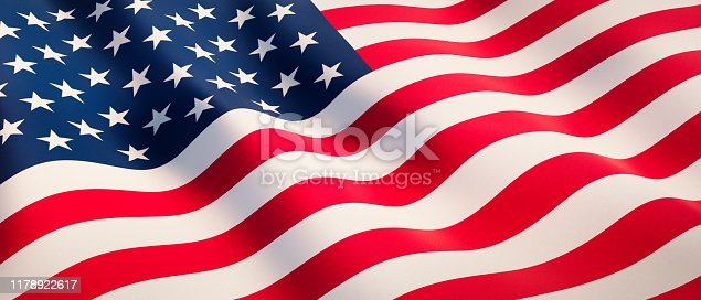 Waving flag of USA in sunny daylight as a background