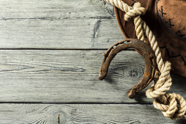 american west still life with old horseshoe - rodeo stock pictures, royalty-free photos & images