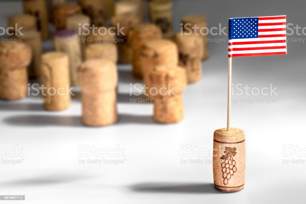 American wine industry with one wine cork bottle stopper with American flag planted in it and multiple corks in background - Photo