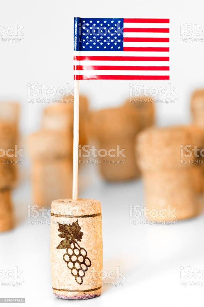 American wine industry with one wine cork bottle stopper with American flag planted in it and multiple corks in background stock photo