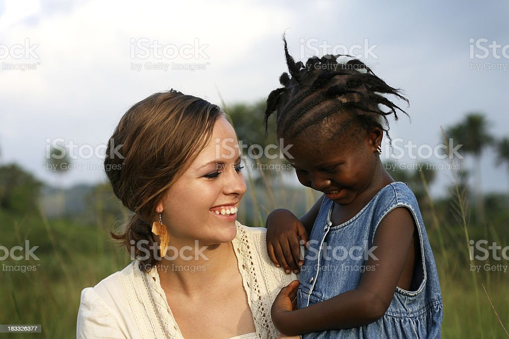 American Woman Holding African Girl royalty-free stock photo