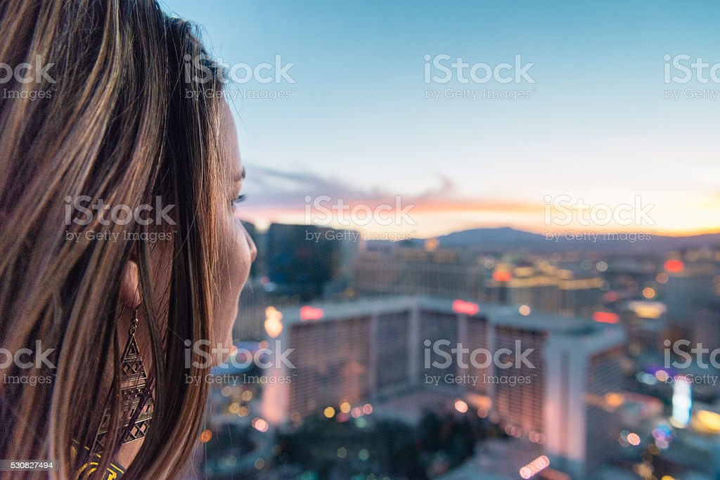 American Woman in 30s Looks at Sunset Las Vegas View stock photo