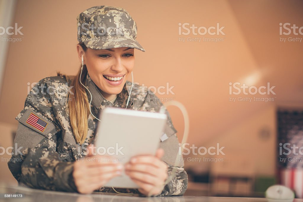 American woman soldier using tablet stock photo
